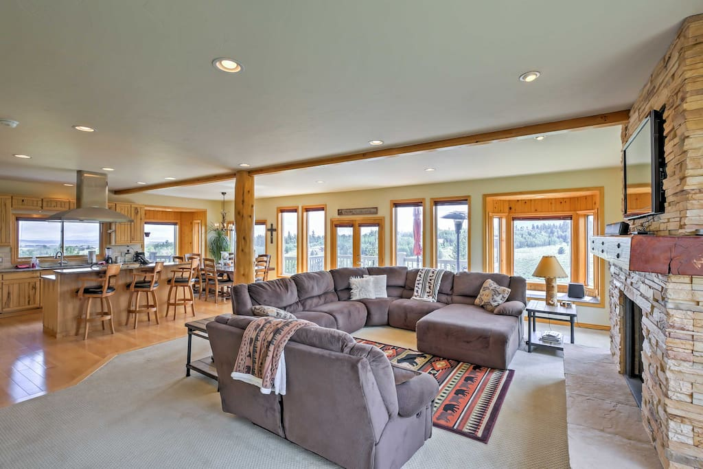 The home boasts an open floor plan and many windows that allow sunshine in.