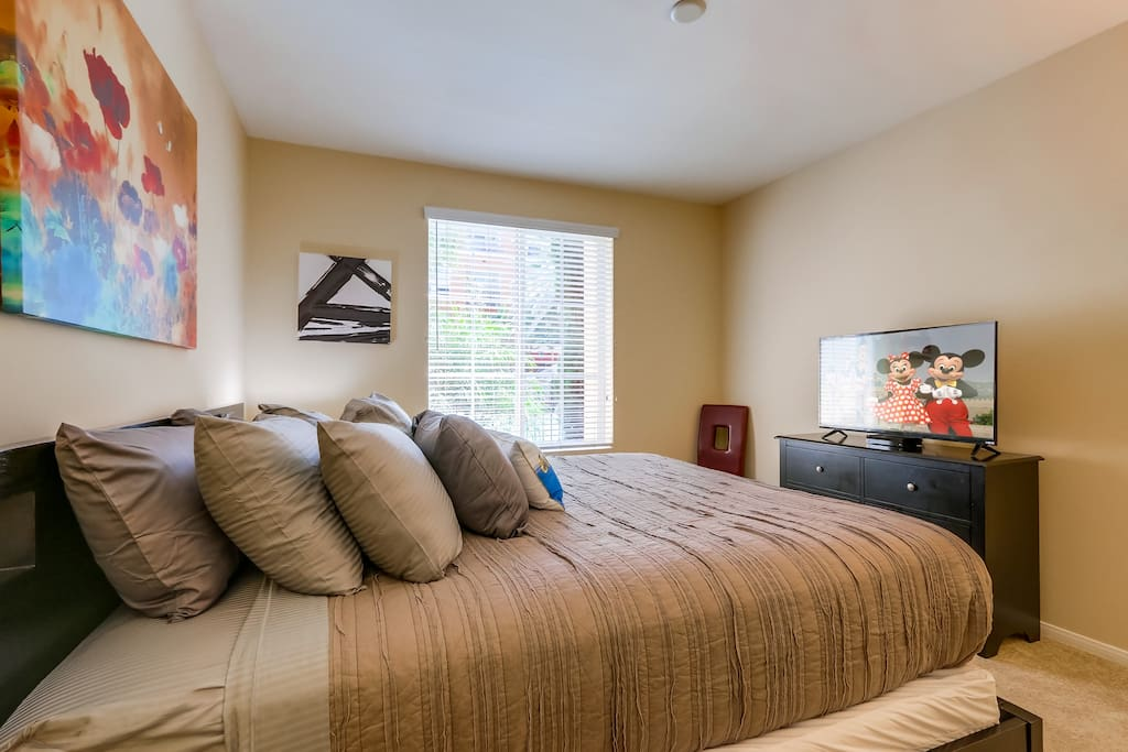 """The master bedroom is made for the ultimate enjoyable luxury experience.  Features a California King pillowtop bed, 42"""" HDTV with cable channels, USB charging station,  walk in closet, mood lighting, pool view, and much more."""