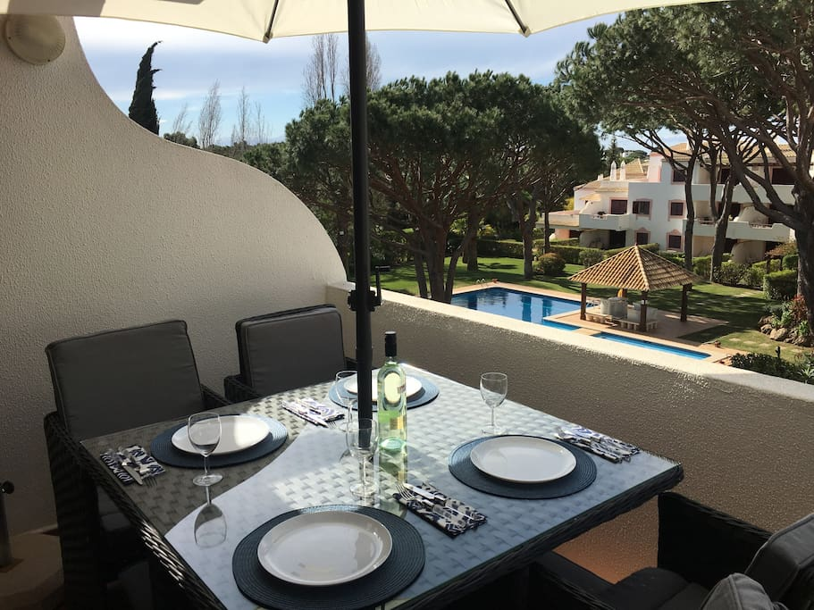 Dining on terrace overlooking pool