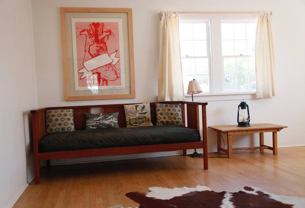 This also in the larger bedroom. This daybed is a mid century design that i made in cherry with maple details and figured cherry panels. You can also see a little bamboo table I made a loooong time ago