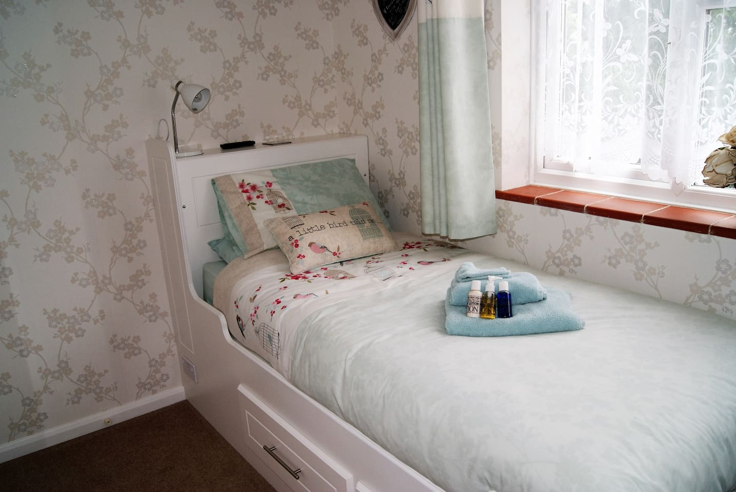 Comfy full sized single bed.
