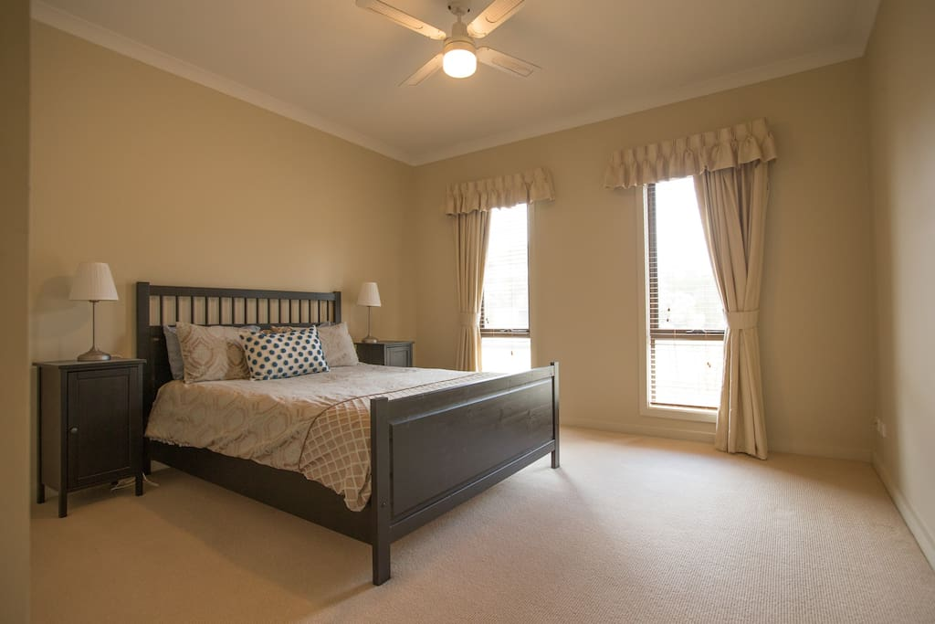 2nd bedroom with built ins and ceiling fan