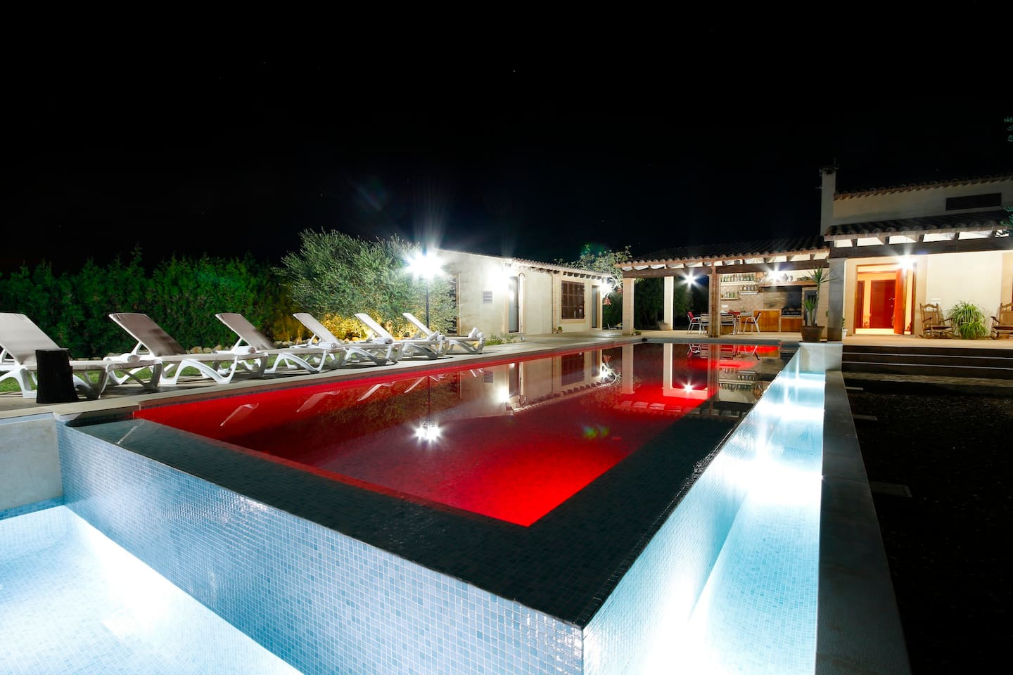Garden with changing pool lights