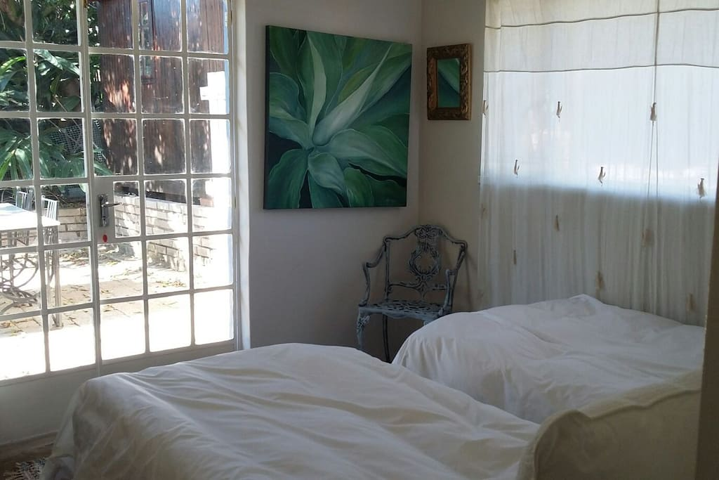 Main bedroom with French doors leading onto the patio
