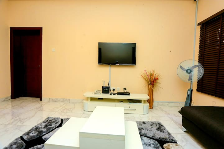 Living room with DSTV Explora and Wifi, alongside board and card games