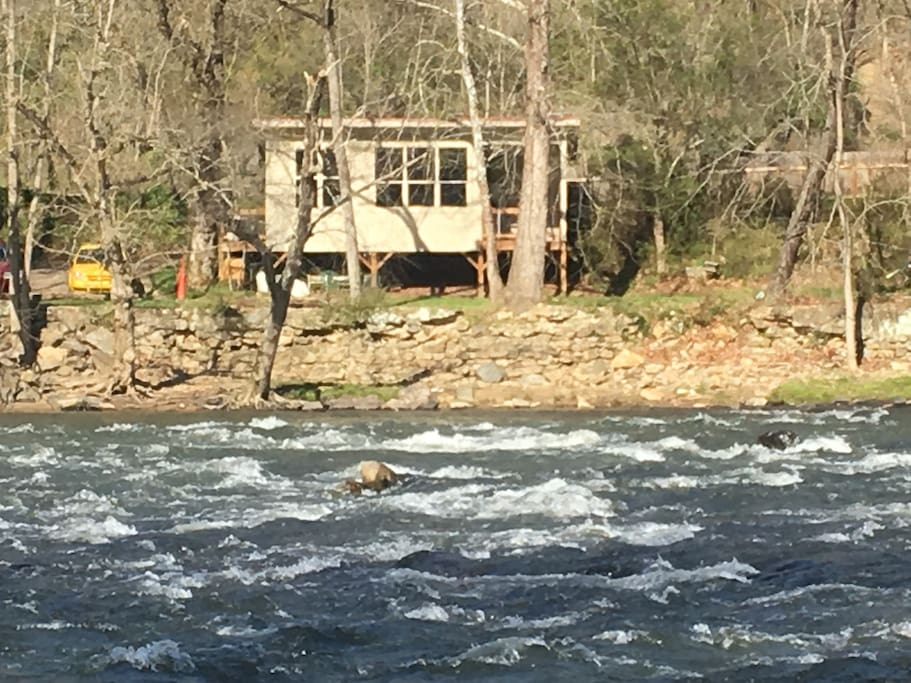 From across the river looking at the camp this the Clarks Driftwood Cabin