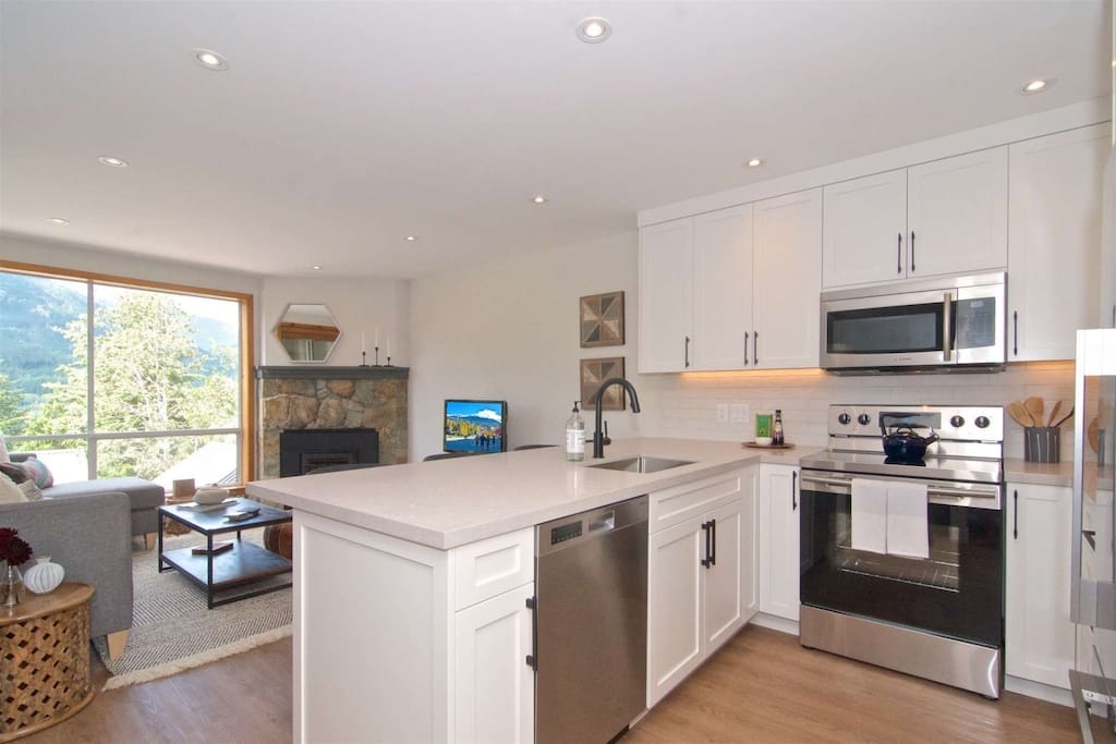 Open concept brand new high end  kitchen with full size appliances