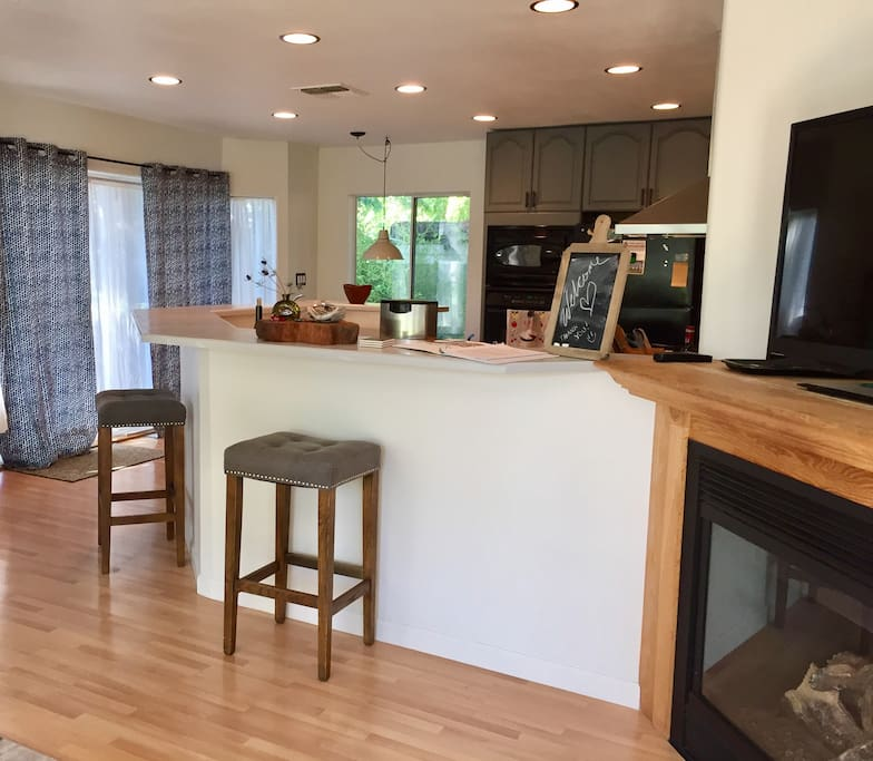 Wrap around bar in kitchen TV and Fireplace