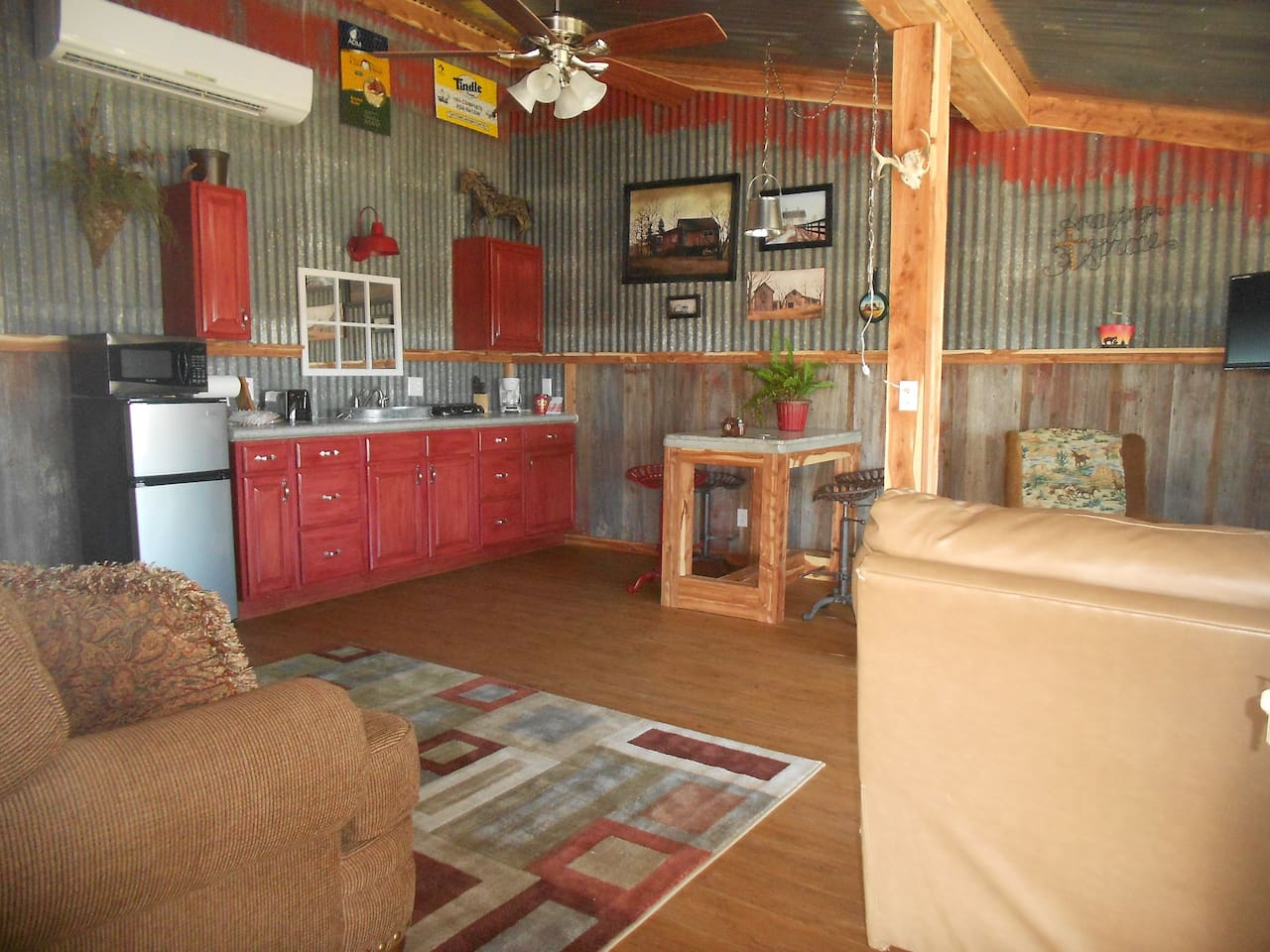 Living/kitchen area Rustic room