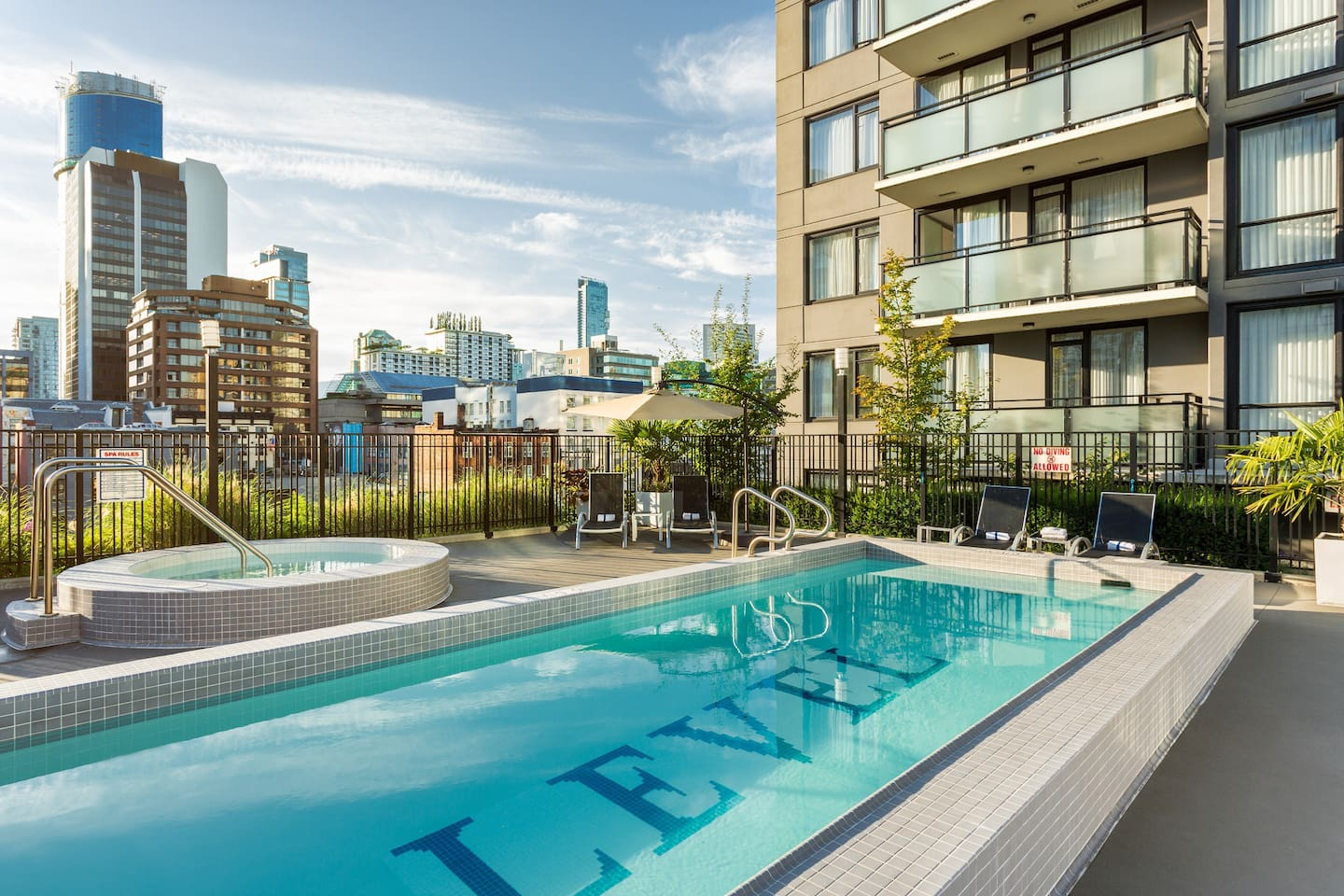 Enjoy our outdoor rooftop heated saltwater pool and hot tub
