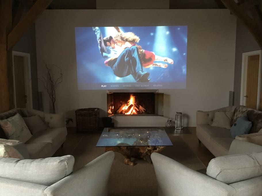 Our lounge has a large fire place and a big screen projector.