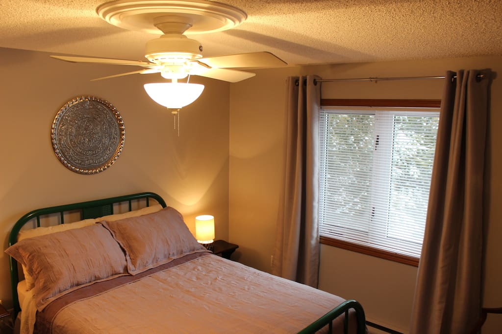 Newly decorated double bedroom with a double bed & lots of closet space overlooking the tree lined backyard.