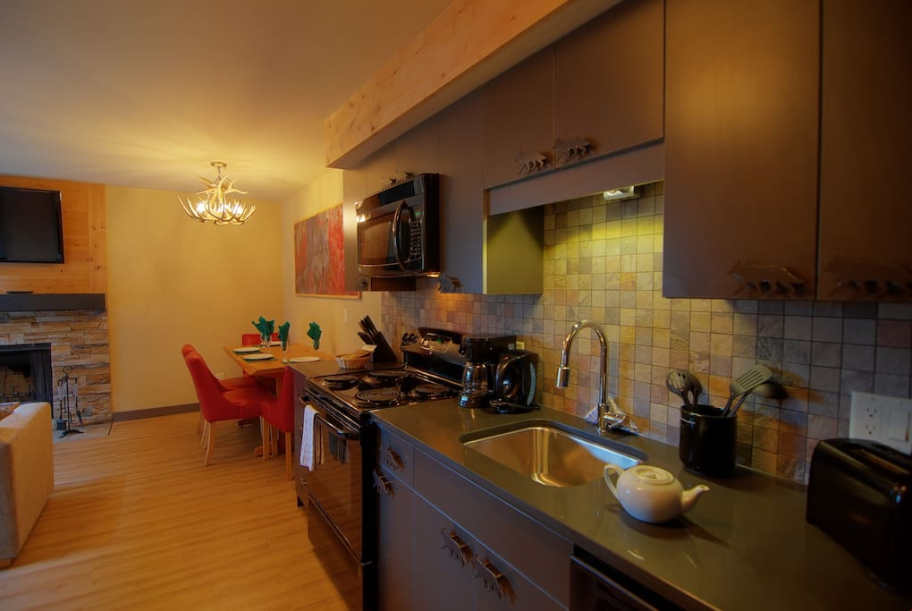 Prepare a meal in the fully-equipped kitchen and enjoy it in the dining area.