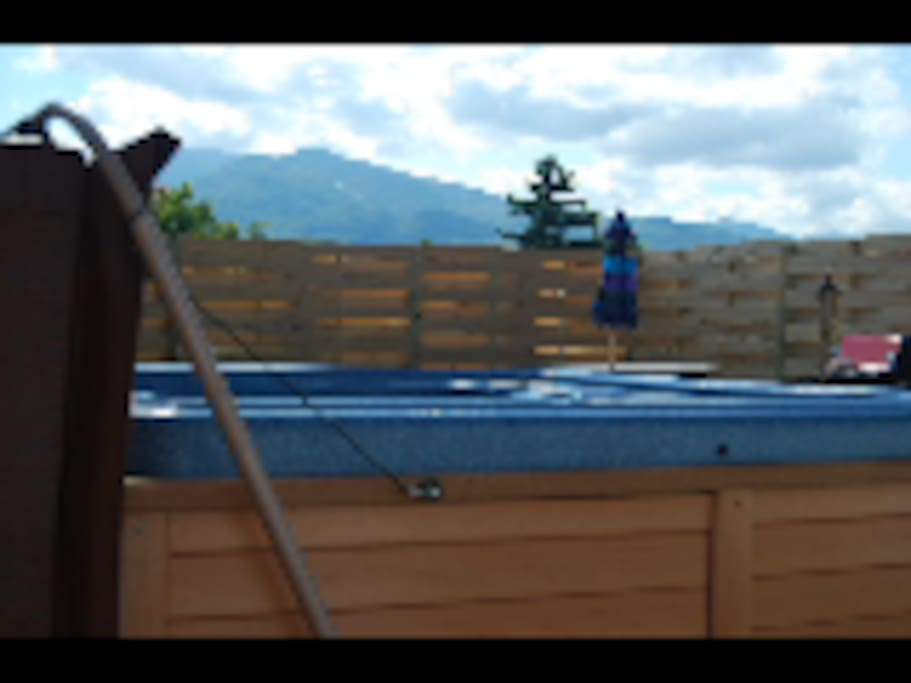 New hot tub and fenced in yard with amazing mountains views
