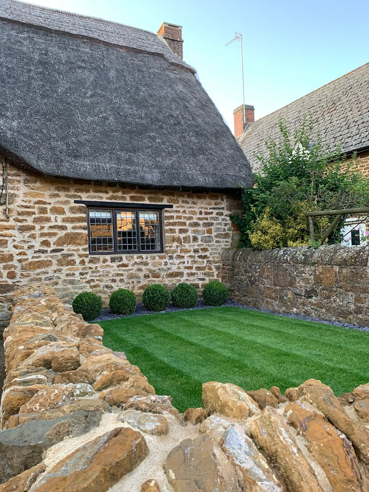 Thatched cottage in quintessential English village