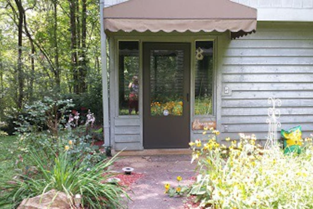 ENTER TO THE SCREENED PORCH