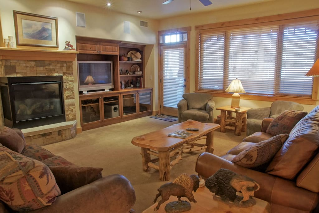 Spacious Living Room with Leather Couch, Pull Out Couch, Rocking Armchairs, HDTV, Surround Sound Stereo, & Fireplace.