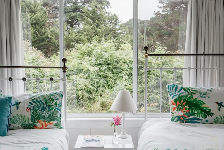 The interiors have been beautifully designed to create a welcoming and comfortable space for guests including fresh flowers and magazines.