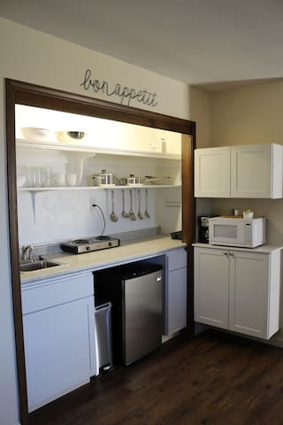 Kitchen is stocked with the essentials including local coffee and breakfast items