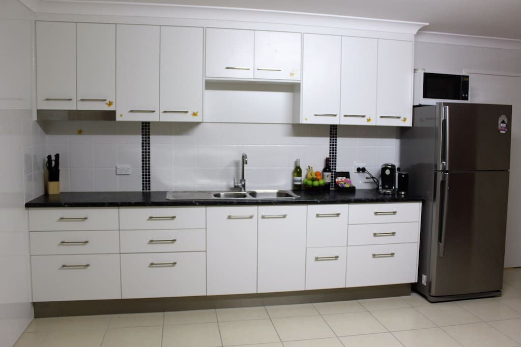 Large fully self contained kitchen with microwave, hot plate, kettle, toaster, coffee machine and large fridge.