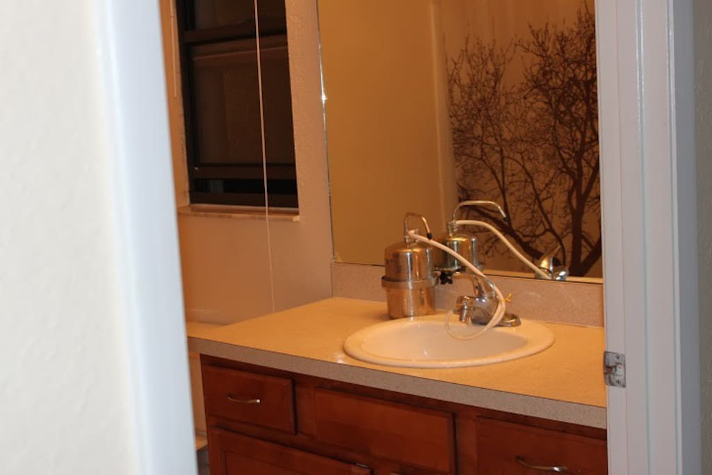 Shared bathroom, includes shampoo, conditioner, soap, towels.