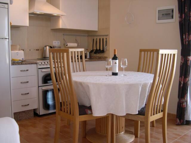 Indoor dining for four.  We always present our guests with a bottle of Bullas Wine to enjoy.  We are very lucky to be living in this beautiful wine region and to have such lovely wine readily available.