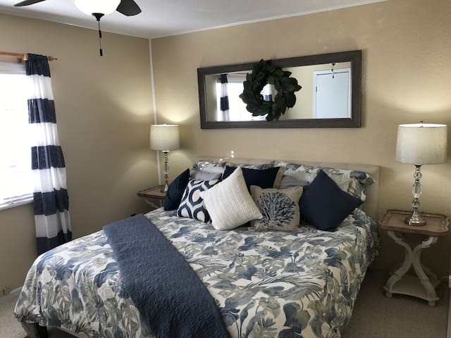 King size bed with walk in closet