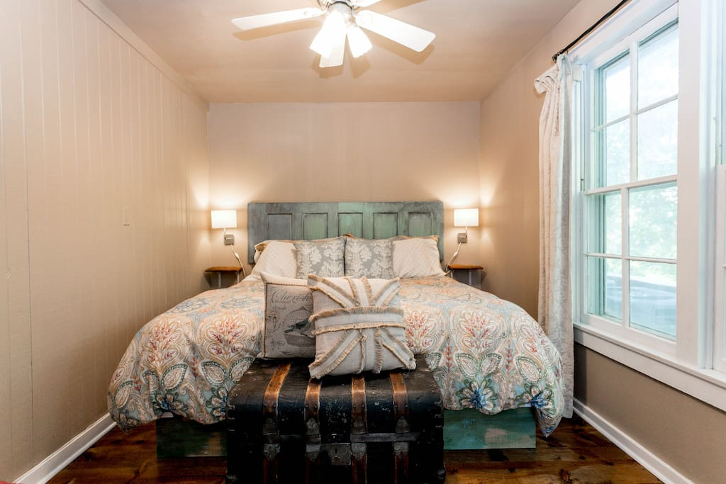 Gorgeous bedroom featuring a king size bed and reclaimed wood floors