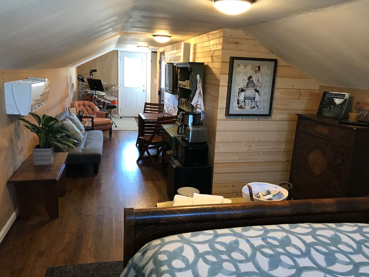 Upstairs Private Suite with bed, futon, dresser, small table and chairs, small kitchenette.