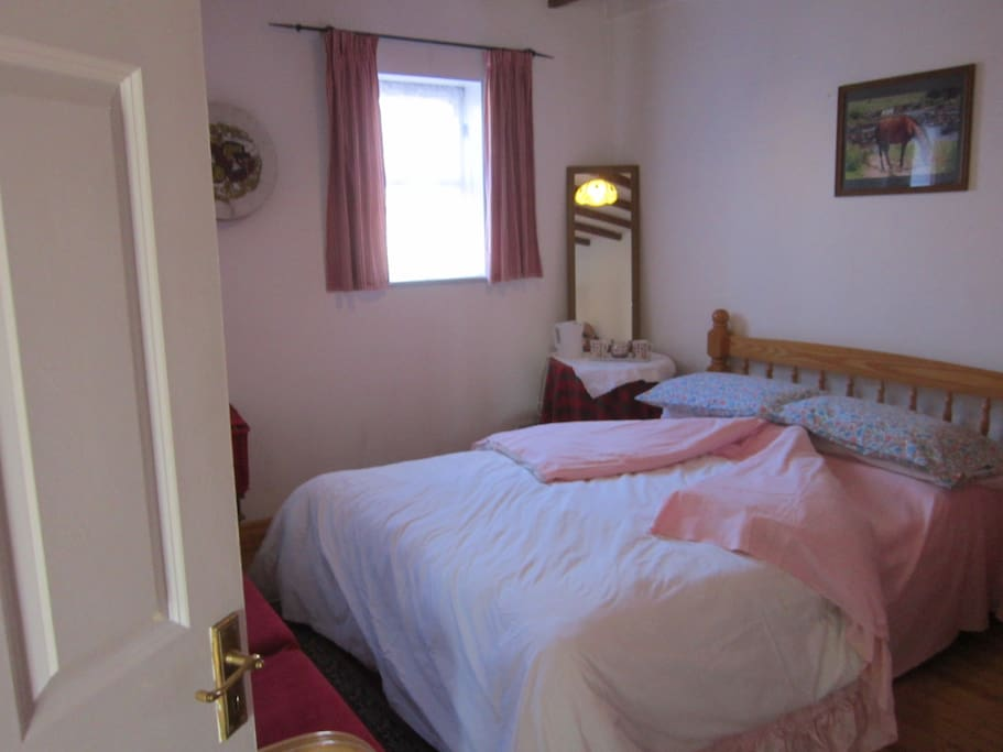 Double room is downstairs, view to the front and has exposed beams on the ceiling.