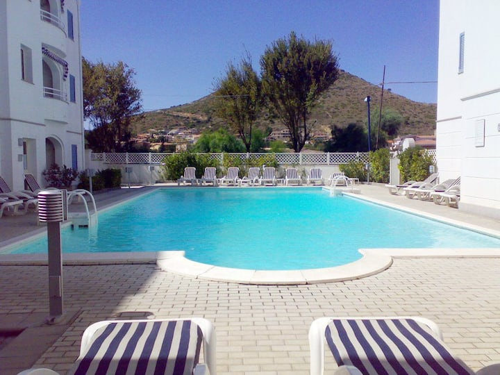 """Holiday Home """"Blu 09"""" close to the Beach with Mountain View, A/C, Shared Pool & Private Terrace; Street Parking Available"""
