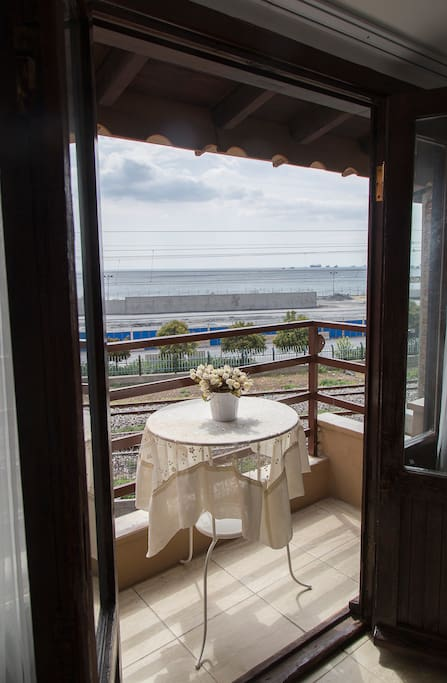 Rooftop room with balcony with sea view and extra bed