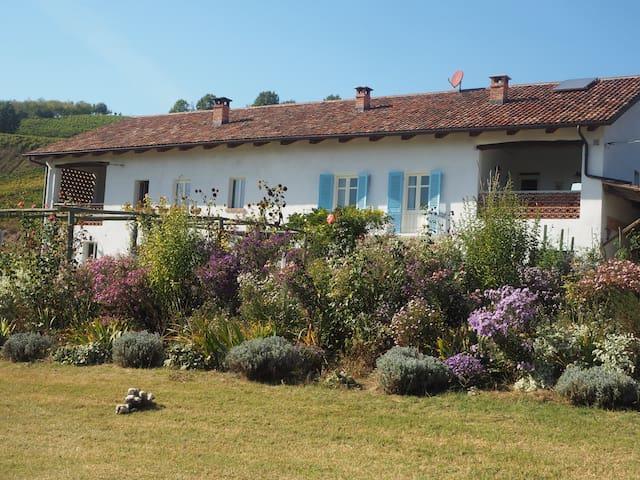 The farmhouse on a sunny Autumn day set in English style garden