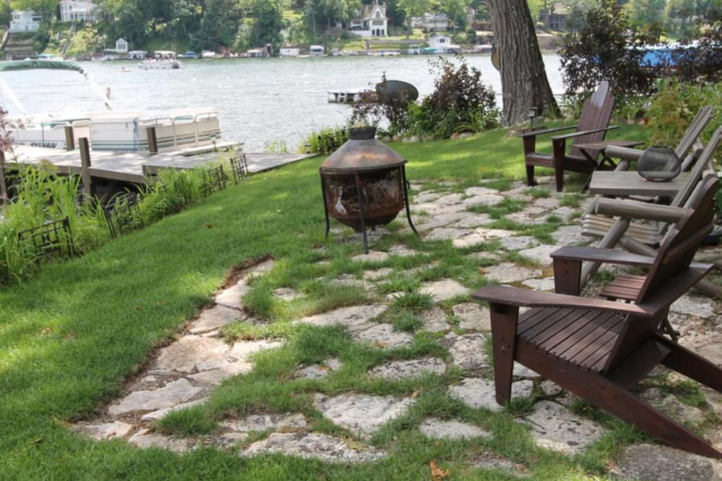 Lakefront patio with outdoor fire kettle