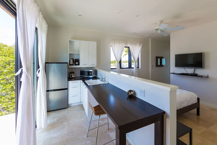 Kitchenette with access to private balcony and table and chairs