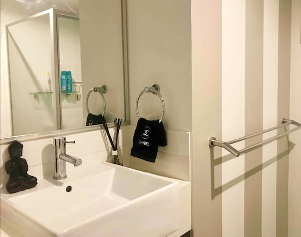 super clean shared bathroom with shower. (hair dryer, shampoo, conditioner and body wash  provided)