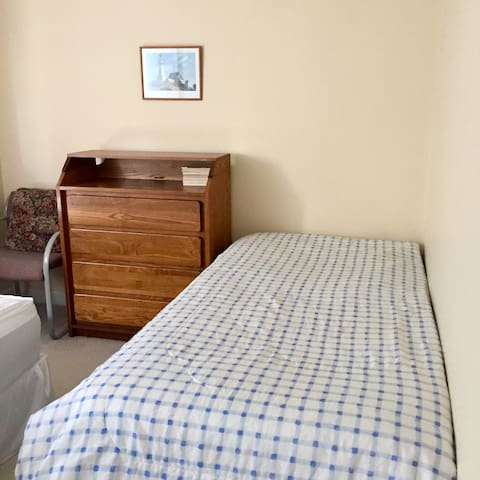 The twin sized bed in the first bedroom