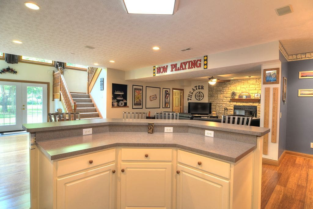 Your kitchen area overlooking your living/movie room (with TV, cable, wi-fi, and blue ray player)
