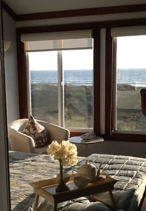 Ocean View with temperpedic king size luxerious bed.  High ceilings, airy, clean, and new.  Private bathroom with shower.