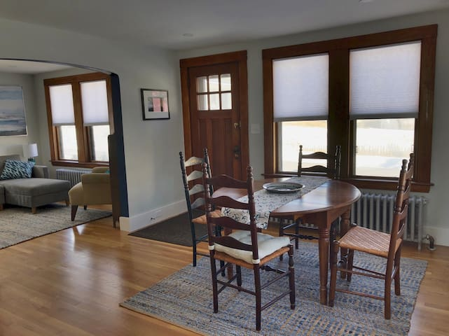 Open concept dining room and living room with refinished oak floors.