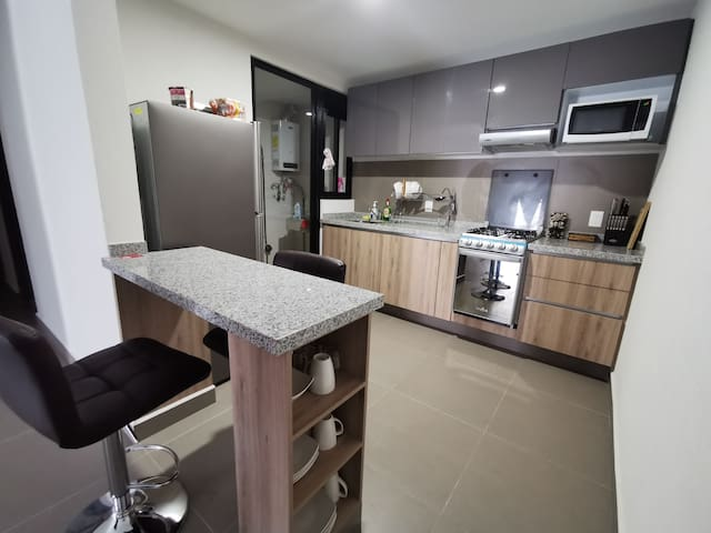Habitación privada con cocina compartida