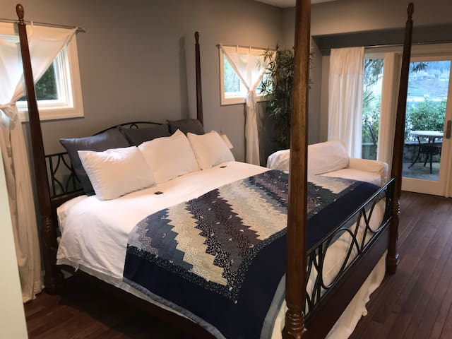 King bed & large sitting area with views of lake.  French doors to patio.