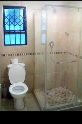 Room with toilet and shower