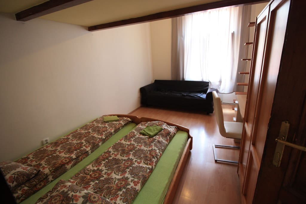 private bedroom for 4 persons , 2 beds down and 2 beds up, writing desk , wardrobe and settee