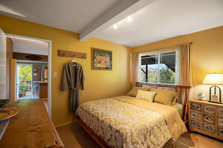 Cozy bedroom with queen bed (organic mattress), a dresser and a closet for hanging your clothing.