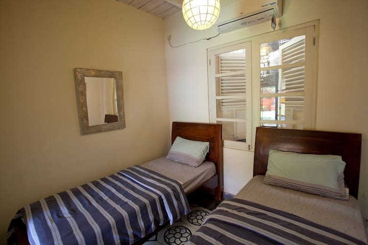 Two full size single beds in the extra bedroom