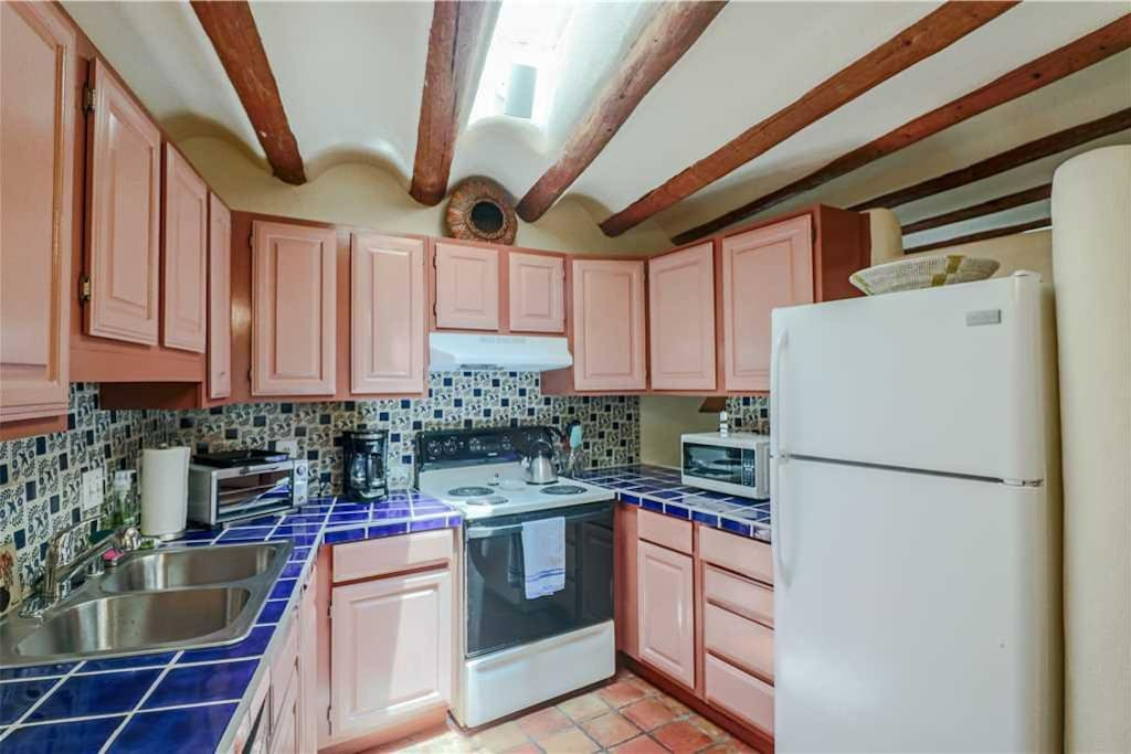 The Kitchen Has It All - From full-size fridge/freezer and oven/stove top cookware to tableware, the kitchen has everything you n