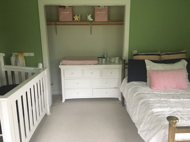 Nursery with full size bed, crib, and changing table. Near master bedroom.