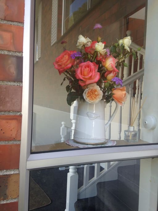 Fresh cut flowers welcome you into our home.