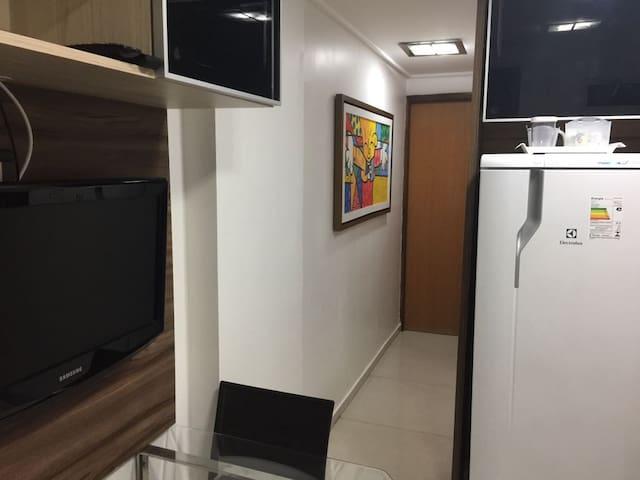 vista do corredor entre a sala e o quarto